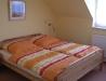 Schlafzimmer mit Doppelbett der Fewo Kyffhausen