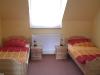 Schlafzimmer mit zwei Einzelbetten der Fewo Kyffhausen